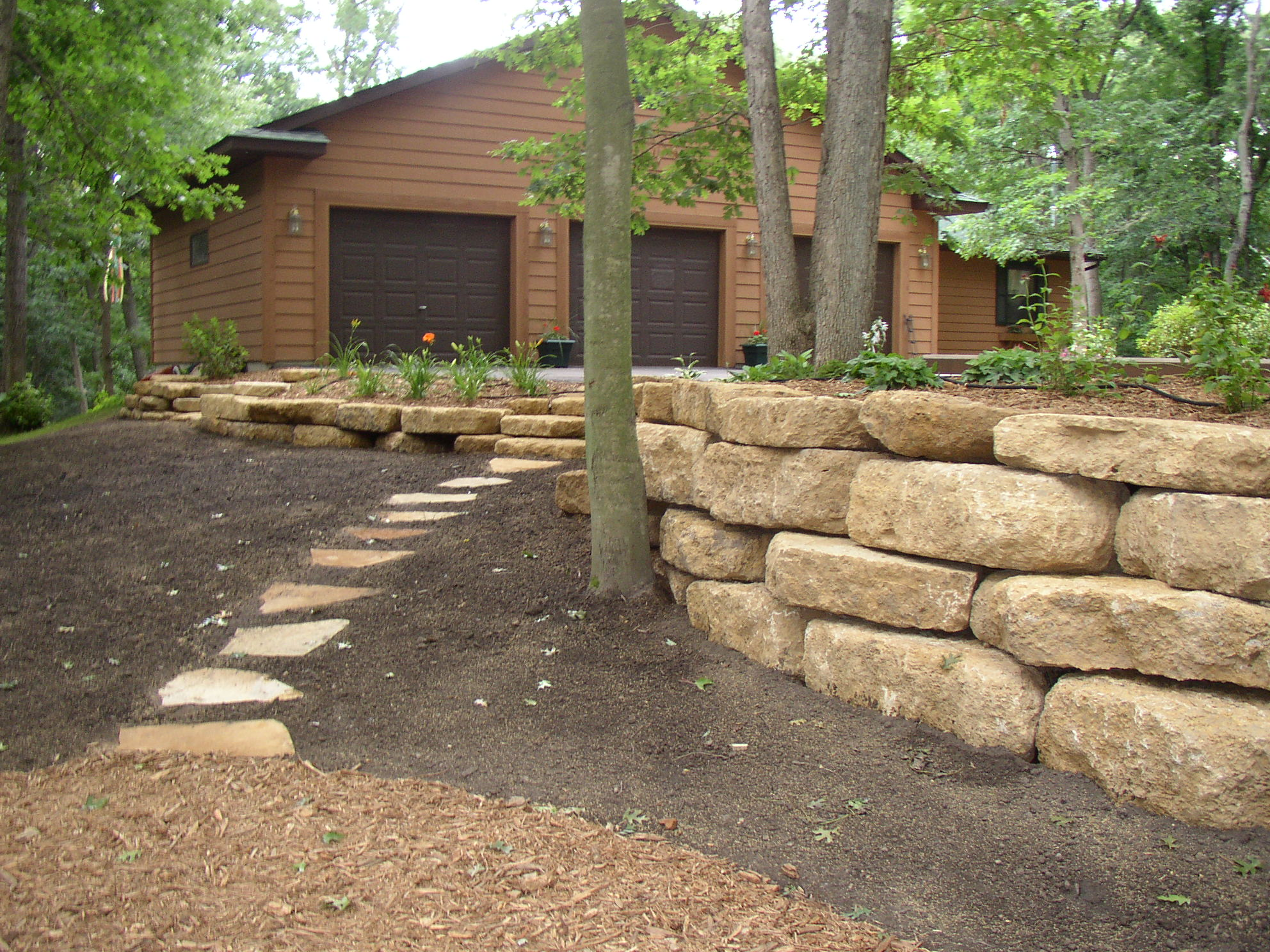 Landscape design tyler 39 s landscaping for Block wall landscape design